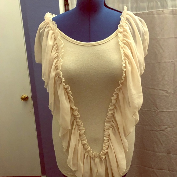 thesis Tops - Beige blouse with ruffles in the front and back.